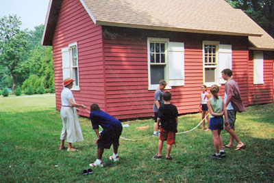 Visiting students playing outside of the schoolhouse